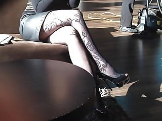 Platform high heels and stockings in hotel lobby
