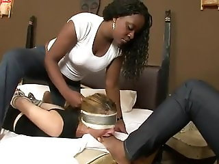 White blonde bitch gagging with the feet of 2 ebony mistress