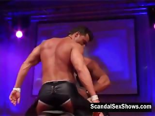 Two male strippers give a  show