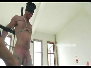 Stunning man is tied up with his hands behind his back photographed and has his cock milked