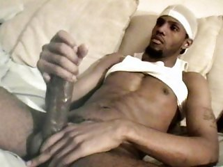 Gangster jerks his big cock daily
