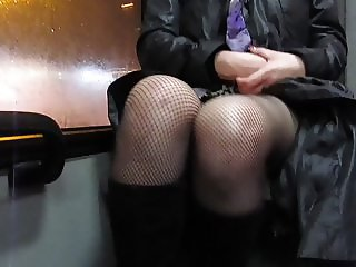 Girl in fishnet stockings flashing pussy in a bus