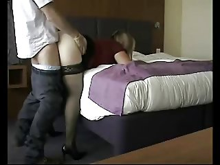 Milf fucked against bed