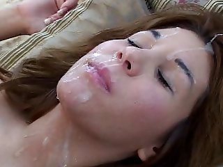 Girl on her back gets a big load in her face and hair