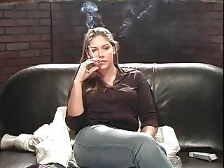 Hottie smokes on couch