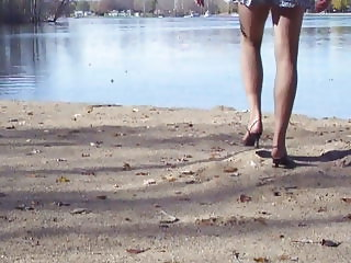Crossdresser at the lake in hose and heels