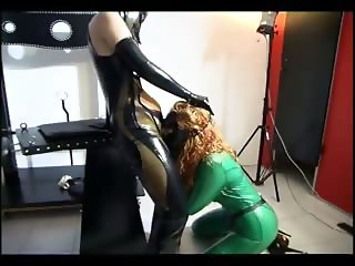 Sexy slave girl sucking a strap on