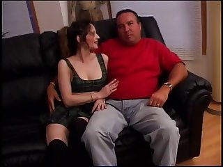 Dark haired slut spreads her legs and gets pussy eaten on a couch