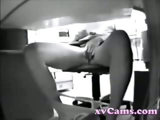 Horny girl masturbates in office