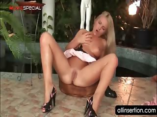 Blonde nympho using her giant dildo to please cunt