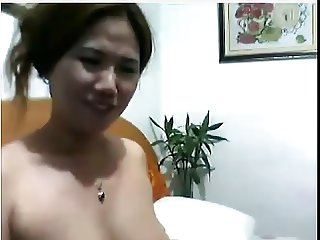 Chinese MILF cums loud.