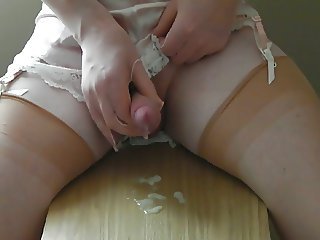 crossdresser wanks with nylon gloves, stockings and cums