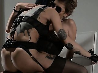 Tatto lesbs enjoying sex with strap on