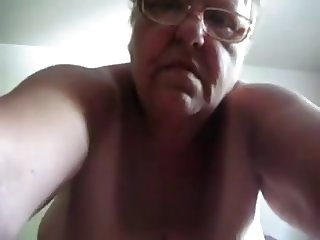Horny Grandma masturbating with dildo
