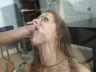 Hot brunette gets her face drenched in cum