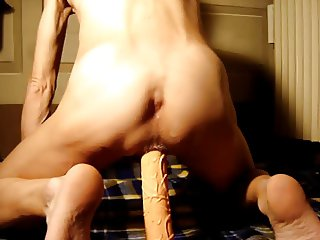 Masked and playing with long dildo - part 3