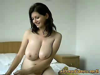 Beautiful babe with big tits plays