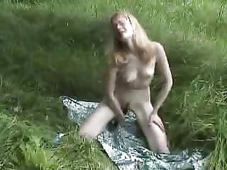 Tanya in the park with her toys