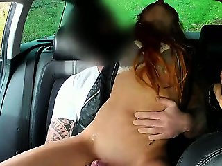 Redhead masturbates and fucks in fake taxi