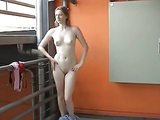 An amateur makes a striptease in a gym