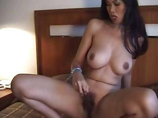 Gorgeous Thai Girl Plays with Dildo on Bed