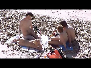Voyeur on public beach. Group sex before spectators
