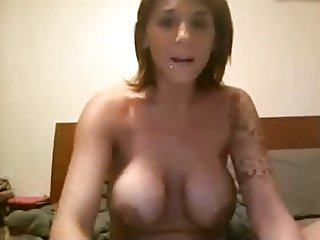 MILF fucks her spread leg pussy with vibe toy