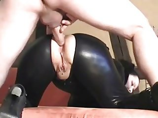 Rubber slave fucked in the ass