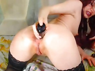 Redhead with meaty pussy lips pounds asshole with toy