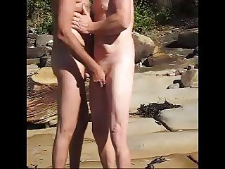 nat and roger have a grope at the beach