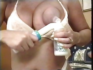Busty mature slut pumps milk from her juicy tits