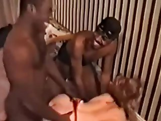 Redheaded wife has a threesome two two black guys
