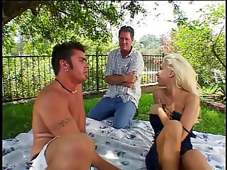 Two guys get head and tag-team busty blonde outdoors