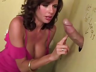 Brunette Milf Veronica services big cock at gloryhole
