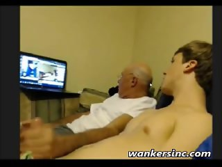 Old and young wank together to porn