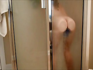 Riding Mounted Purple Dildo In The Shower