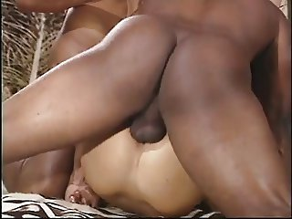 Two african males with donkey cocks fuck brunette