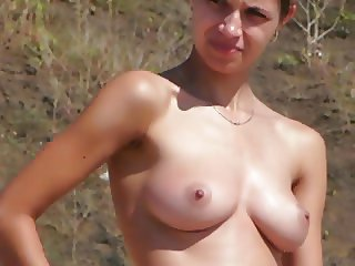 Nudist girl with shaved pussy filmed on beach