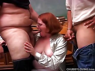 Cute chubby redhead sucks two cocks at the same time