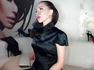 MILF in black satin blouse