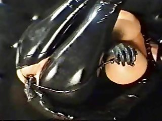 masked girl in latex gets anal training