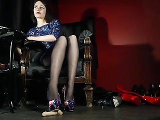 Mistress Hellena trampling with hosed feet on....
