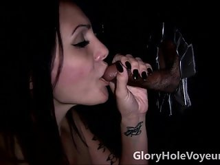 Brunette Blows Black Cock in Gloryhole