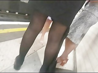 Business woman in shiny opaque black tights