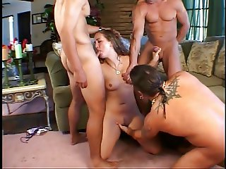 Slut getting fuck holes filled in gang bang
