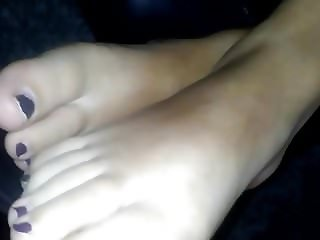 Just feet soles toes with chipped nail Polish