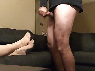 spraying on wife's newly pedicured feet