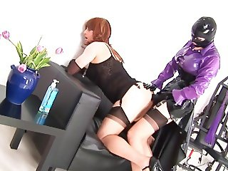 female in latex strapon fucks a male in latex