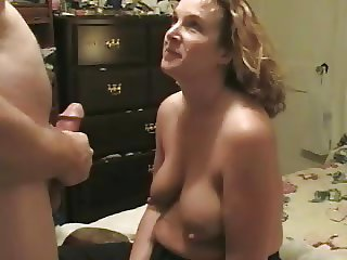 saggy tit wife giving a blowjob