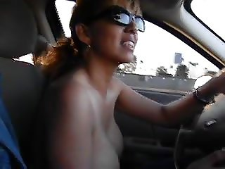 Nina Latina driving topless